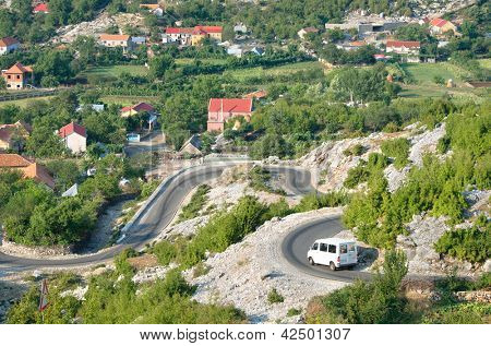 white minibus on the winding road from Razem to Shkoder, Albania