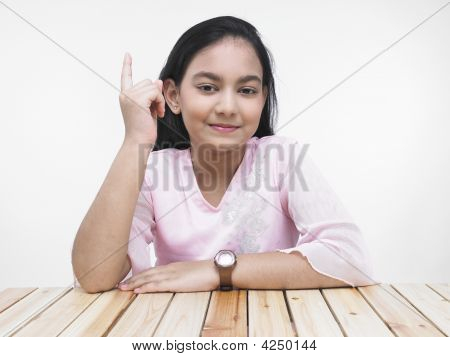 Asian Teenage Girl Showing Her Index Finger