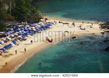 Tropical sandy beach and calm lagoon with clear blue water. Pseudo tilt shift. Ya Nui beach, Phuket, Thailand