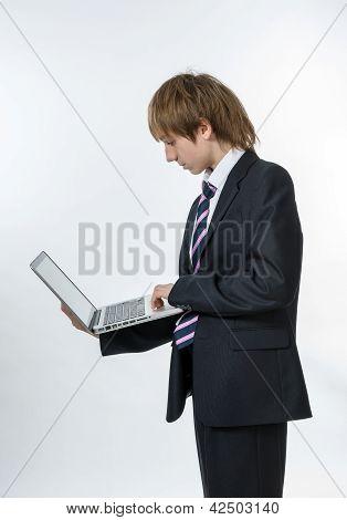 Teenage Boy Working In White Laptop