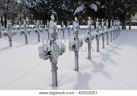 Crosses in cemetery in winter