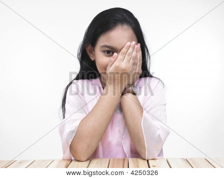 Asian Girl Covering Her Left Eye With Her Palm