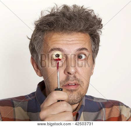 Man in horror looking at your own eyes