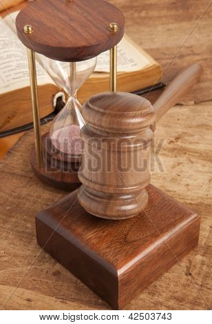 Wooden gavel and old clock
