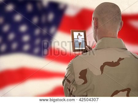 Conscript  marine looks at the photo of the girlfriend