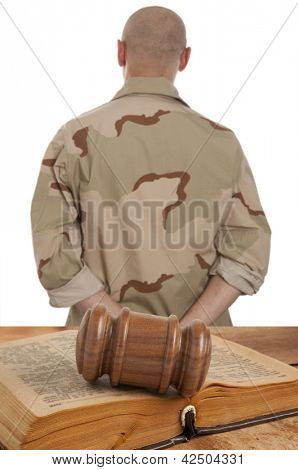 Soldier in courtroom isolated on white