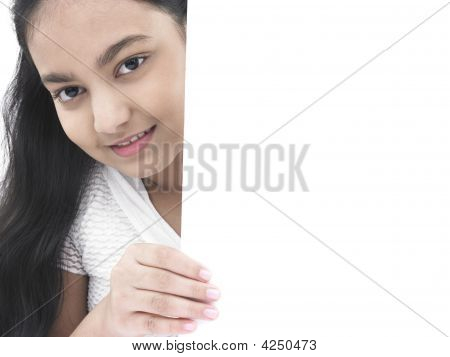 Asian Teenage Girl Of Indian Birth With A Blank Placard