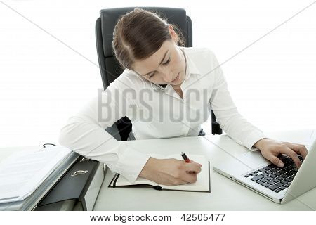 Young Brunette Business Woman Is Busy With Telefon And Laptop