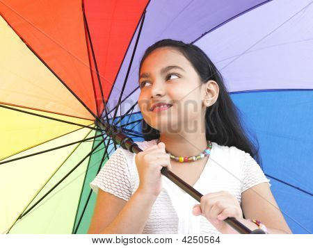 Asian Girl Of Indian Origin With A Rainbow Umbrella