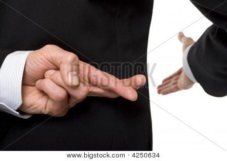 Crossed Fingers At Handshake