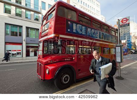 Routemaster Departs From The Bus Stop, London