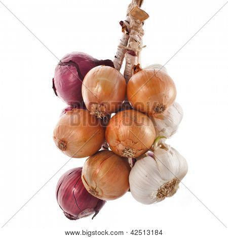 hanging bunch bundle of onion and garlic clove isolated on white background