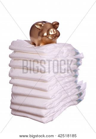 Stack Of Diaper With Golden Piggybank
