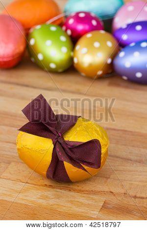 golden easter egg on wooden table