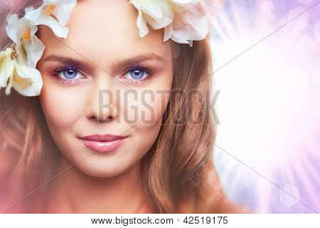 Creative image of an adorable female model with shining sun on background