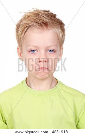 Cute little boy looking at camera with offended expression