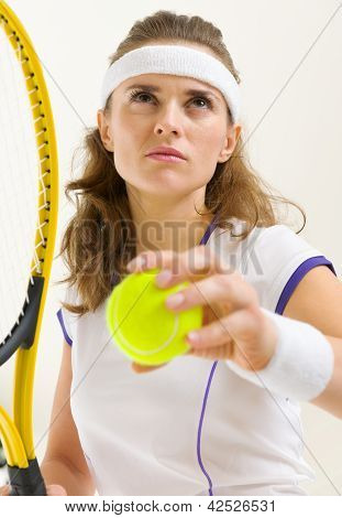 Portrait Of Confident Tennis Player Ready To Serve