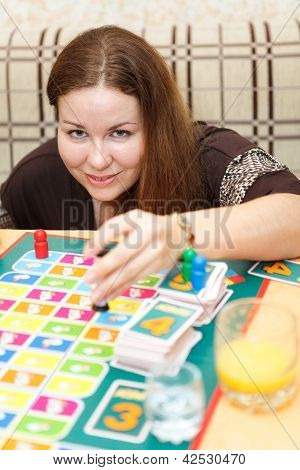 Caucasian Young Woman Playing Board Games In Domestic Room