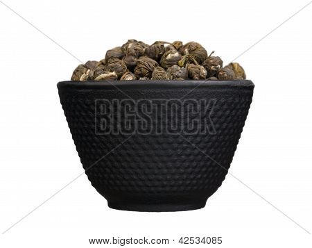 Iron Bowl With Chinese Dry Green Tea Isolated On White