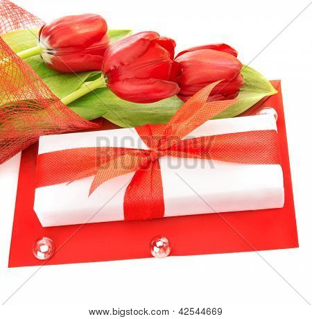 Picture of white gift box with red ribbon, fresh tulips flower bouquet, paper card, greeting postcard, isolated on white background, happy mothers day, romantic still life, love concept
