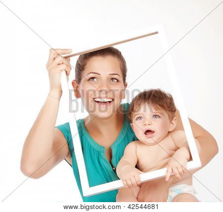 Picture of cute brunette woman holding her cute little son isolated on white background, nice mother hugging her adorable child and holding in hands white frame, happy motherhood, love concept