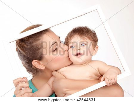 Picture on beautiful young mother kiss her little son isolated on white background, pretty female with cute naked child in white frame, happy childhood, health care, cheerful family, love concept