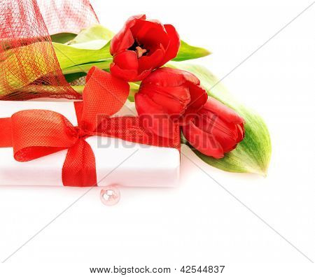 Photo of beautiful red tulips bouquet with gift box isolated on white background, romantic present for birthday, happy mothers day, holiday celebration, spring time, love and happiness concept