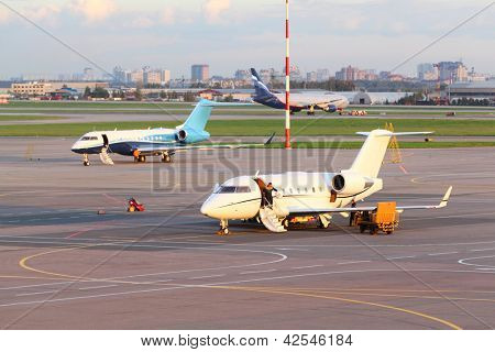 MOSCOW - SEP 22: Airliners stand on runway in Sheremetyevo airport on Sep 22, 2011 in Moscow, Russia.  Sheremetyevo airport was opened on 11 August 1959.