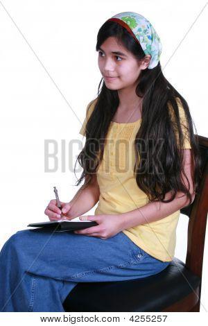 Teenage Girl Taking Notes