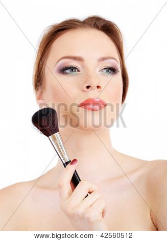 portrait of beautiful woman with make-up brush for powder, isolated on white
