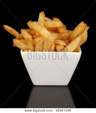 French fries in bowl isolated on black