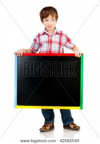 Cute boy holding a blackboard over white background