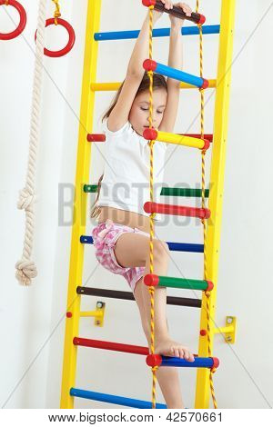 7 years old child playing on sports equipment