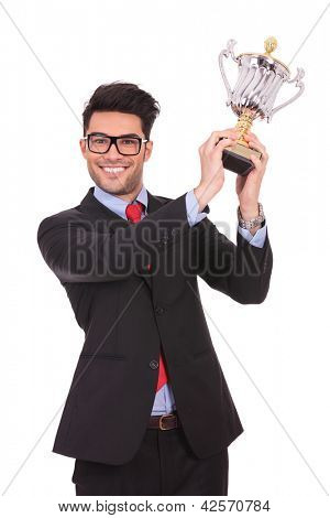 business man raising his trophy and smiling to the camera, on white background