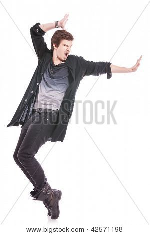 young male dancer showing some skill, on tiptoes, showting