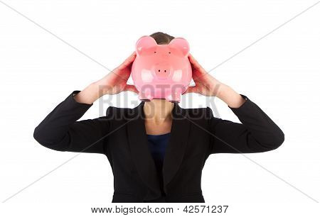 Business Woman Holding A Piggy Bank In Front Of Her Face