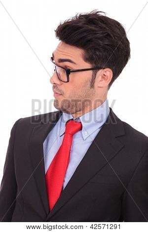 portrait of a young business man looking amazed at something from his side, on white background