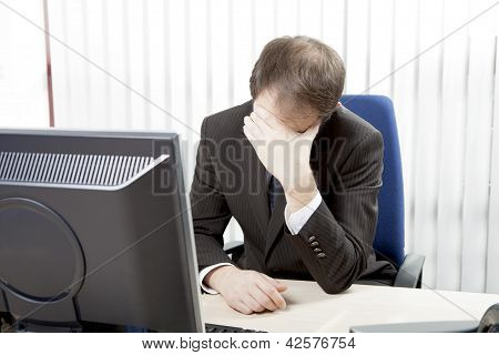 Despairing Businessman At His Desk