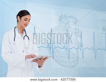 Cheerful cardiologist using a tablet pc in front of heartbeat line
