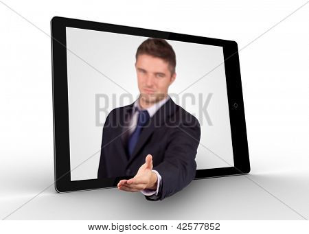 Businessman reaching out from tablet for a handshake on white background