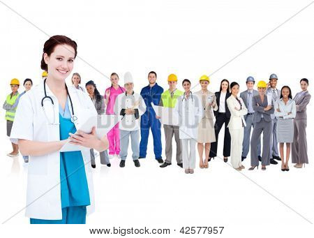 Pretty doctor standing in front of diverse career group on white background