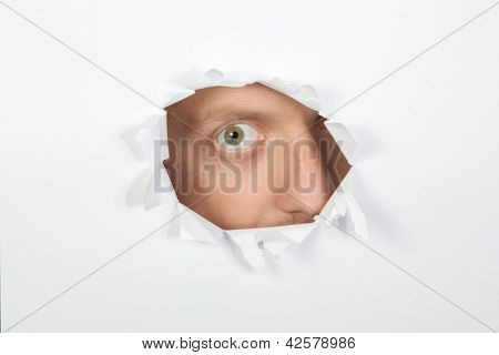 A Secret Look Through The Hole In The Paper.