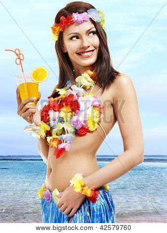 Woman in hawaii costume drink  juice. Outdoor.