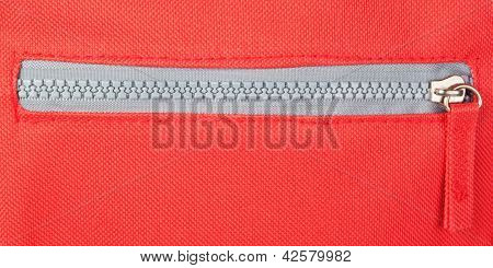Zipper On A Red Background. Fastener.