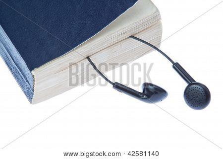 Handbook And Headphones. On A White Background.