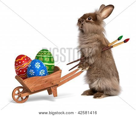 Funny Easter Bunny Rabbit With A Wheelbarrow And Some Easter Eggs