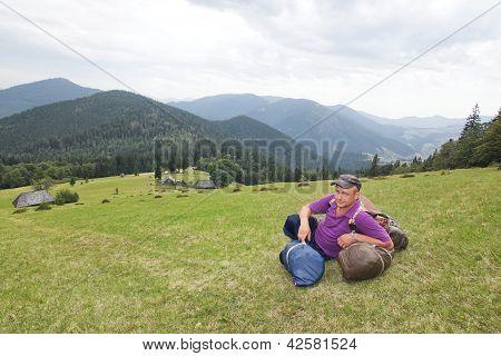Sedentary Tourist In Mountains Carpathians.