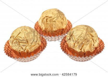 Gift Ideas Wrapped Chocolate Candies. On A White Background.