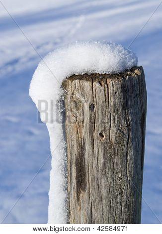 Snowy Wooden Pole