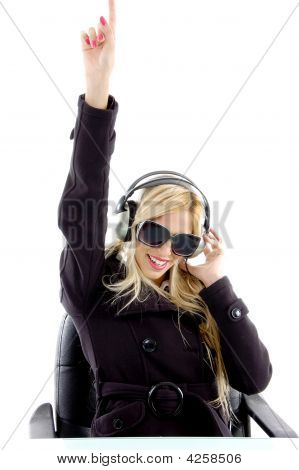 Front View Of Pointing Woman Enjoying Music